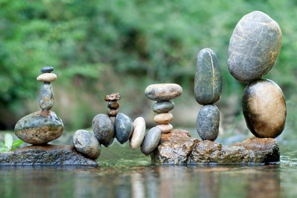 happily balanced pebbles