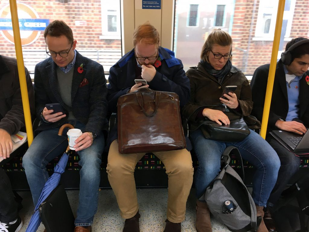 People glued to their phones on the 'drain'